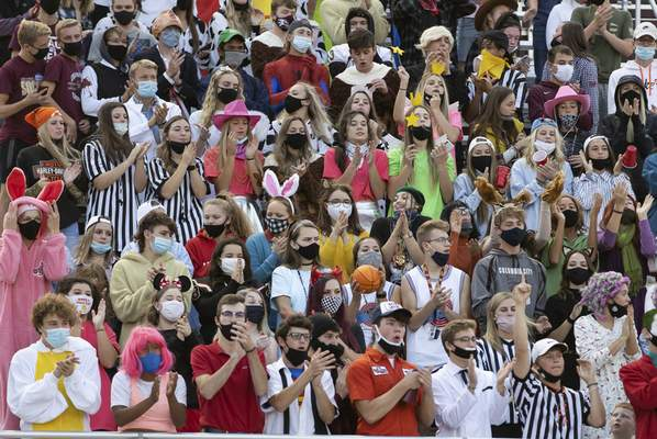 Josh Gales | Journal Gazette The Columbia City student section cheers on their team during the first quarter of the game at Columbia City High School on Friday.