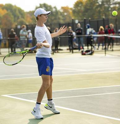 Rachel Bellwood | The Journal Gazette Homestead's Stephen Meier hits the ball to Westview during Boys Tennis Sectional hosted at Homestead High School on Saturday