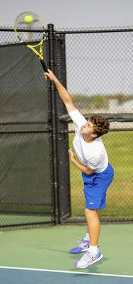 Rachel Bellwood | The Journal Gazette Homestead's Thaddeus Dressel serves the ball to Westview during Boys Tennis Sectional hosted at Homestead High School on Saturday
