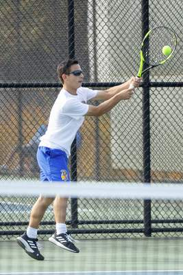 Rachel Bellwood | The Journal Gazette Homestead's Jared Sagan hits the ball to Westview during Boys Tennis Sectional hosted at Homestead High School on Saturday