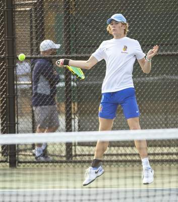 Rachel Bellwood | The Journal Gazette Homestead's Sebastian Cowan hits the ball to Westview during Boys Tennis Sectional hosted at Homestead High School on Saturday