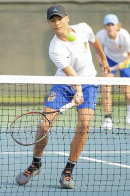 Rachel Bellwood | The Journal Gazette Homestead's Alex Graber hits the ball to Westview during Boys Tennis Sectional hosted at Homestead High School on Saturday