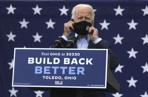 Associated Press Democratic presidential candidate Joe Biden takes off his mask to speak during his rally with United Auto Workers in Toledo on Monday.