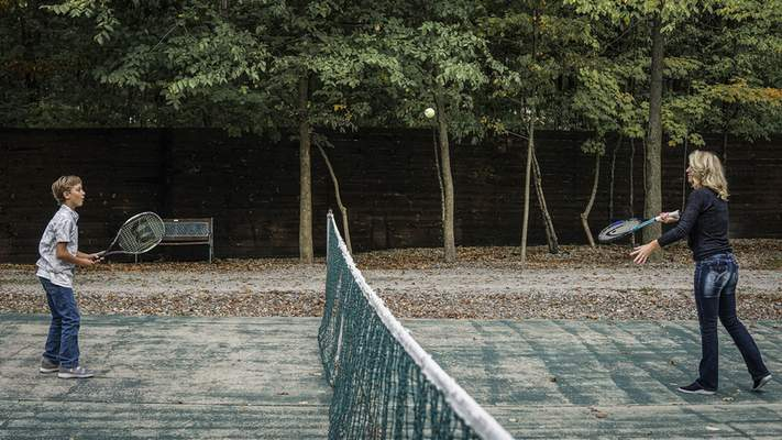 Trazz Holsworth, 10, plays tennis with his mother, Jacy Holsworth.