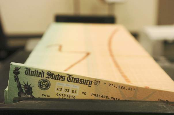 FILE - In this Feb. 11, 2005 file photo, trays of printed social security checks wait to be mailed from the U.S. Treasury's Financial Management services facility in Philadelphia. (AP Photo/Bradley C. Bower, File)