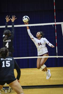 Mike Moore | The Journal Gazette Concordia senior Mya Williams hits the ball in the first period against Concordia during the IHSAA Volleyball Sectional at Bishop Dwenger on Tuesday.