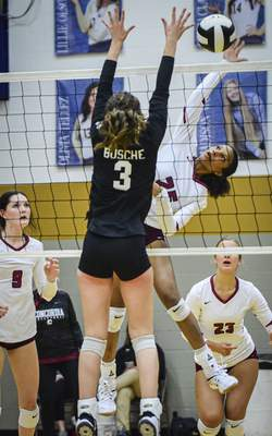 Mike Moore | The Journal Gazette Concordia senior Taylor Hepburn, right, spikes the ball in the first period against Leo during the IHSAA Volleyball Sectional at Bishop Dwenger on Tuesday.
