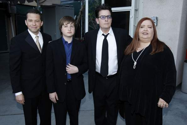 """FILE - Jon Cryer, from left, Angus T. Jones, Charlie Sheen and Conchata Ferrell appear backstage at the TV Land Awards on April 19, 2009, in Universal City, Calif. Ferrell, who became known for her role as Berta the housekeeper on TV's """"Two and a Half Men,"""" has died. Ferrell was 77. A publicist says the actor died in the Sherman Oaks neighborhood of Los Angeles following cardiac arrest, with her family at her side. (AP Photo/Matt Sayles, File)"""