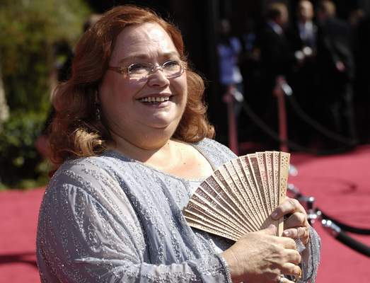 """FILE - Conchata Ferrell arrives at the 59th Primetime Emmy Awards on Sept. 16, 2007, in Los Angeles. Ferrell, who became known for her role as Berta the housekeeper on TV's """"Two and a Half Men,"""" has died. Ferrell was 77. A publicist says the actor died in the Sherman Oaks neighborhood of Los Angeles following cardiac arrest, with her family at her side. (AP Photo/Chris Pizzello, File)"""