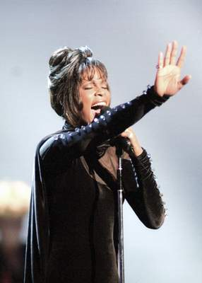 FILE - Whitney Houston performs during the 21st American Music Awards at the Shrine Auditorium in Los Angeles on Feb. 7, 1994. (AP Photo/Mark J. Terrill, File)
