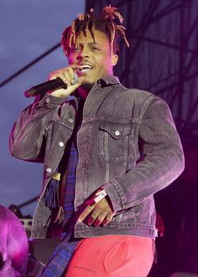 FILE - In this May 15, 2019 file photo, Juice WRLD performs in concert during his Death Race for Love Tour at The Skyline Stage at The Mann Center for the Performing Arts in Philadelphia. (Photo by Owen Sweeney/Invision/AP, File)
