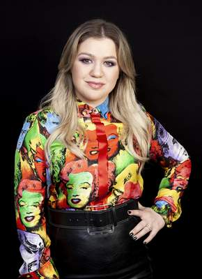 FILE - This April 14, 2019 photo shows singer and actress Kelly Clarkson posing for a portrait at the Four Seasons Hotel in Los Angeles. (Photo by Rebecca Cabage/Invision/AP, File)