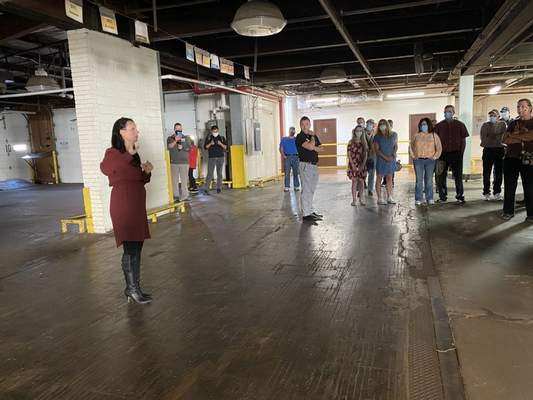 Jamie Duffy | Journal Gazette Ashley Wagner, YLNI Farmers Market manager, leads a tour at the former Perfection/Aunt Millie's bakery on Pearl Street where the winter farmers market will open Oct. 24 for a 27-week run.