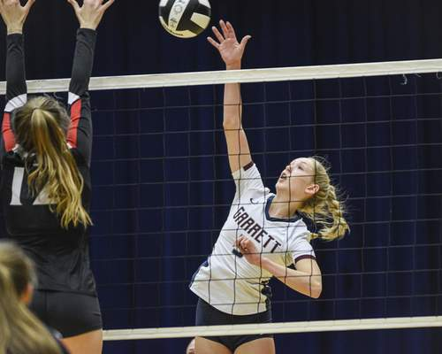 Mike Moore | The Journal Gazette Garrett senior Emma Hirchak spikes the ball in the first period against Bishop Luers on Thursday during the IHSAA Volleyball Sectional at Bishop Dwenger High School.
