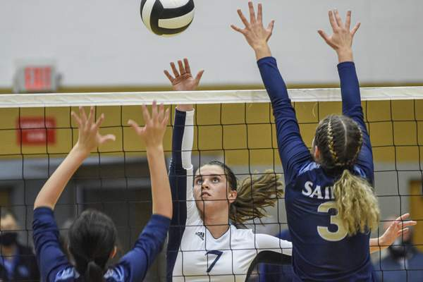 Mike Moore | The Journal Gazette Woodlan junior Reagan Salzbrenner hits the ball in the second period against Dwenger on Thursday during the IHSAA Volleyball Sectional at Bishop Dwenger High School.