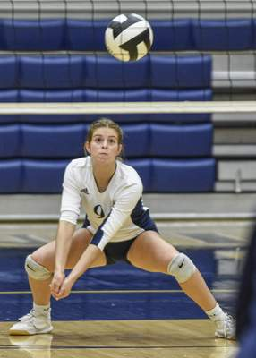 Mike Moore | The Journal Gazette Woodlan junior Maddie Snyder sets the ball in the first period against Dwenger on Thursday during the IHSAA Volleyball Sectional at Bishop Dwenger High School.