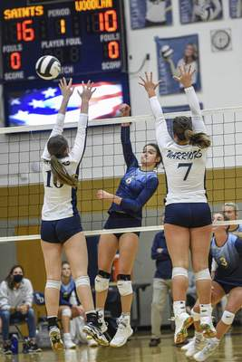 Mike Moore | The Journal Gazette  Dwenger junior Eva Hudson spikes the ball in the first period against Woodlan on Thursday during the IHSAA Volleyball Sectional at Bishop Dwenger High School.