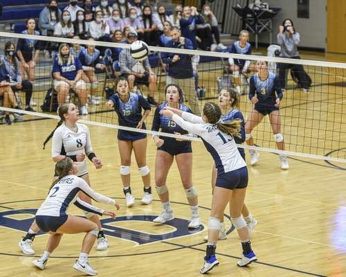Mike Moore | The Journal Gazette  Woodlan and Bishop Dwenger play on Thursday in the IHSAA Volleyball Sectional at Bishop Dwenger High School.