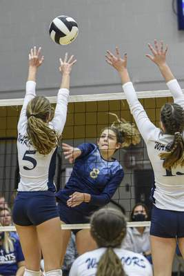 Mike Moore | The Journal Gazette  Dwenger junior Kristin Bobay spikes the ball in the first period against Woodlan on Thursday during the IHSAA Volleyball Sectional at Bishop Dwenger High School.