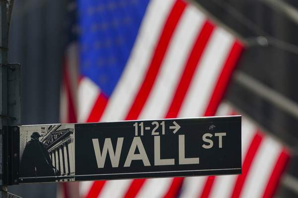 The American Flag hangs outside the New York Stock Exchange Wednesday, Oct. 14, 2020, in New York. (AP Photo/Frank Franklin II)