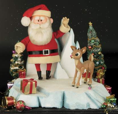 This image released by Profiles in History shows a Santa Clause and Rudolph reindeer puppet used in the filming of the 1964 Christmas special Rudolph the Red-Nosed Reindeer. (Profiles in History via AP)