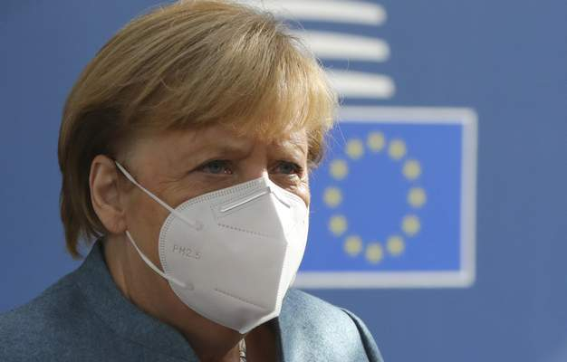 German Chancellor Angela Merkel arrives for an EU summit at the European Council building in Brussels, Thursday, Oct. 15, 2020. (AP Photo/Olivier Matthys, Pool)