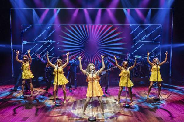 This image released by Polk & Co. shows Adrienne Warren, center, during a performance of Tina: The Tina Turner Musical. (Manuel Harlan/Polk & Co. via AP)