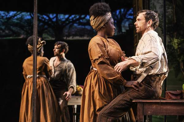 This image released by DKC O&M shows Paul Alexander Nolan, right, and Joaquina Kalukango during a performance of Slave Play. (Matthew Murphy/DKC O&M via AP)