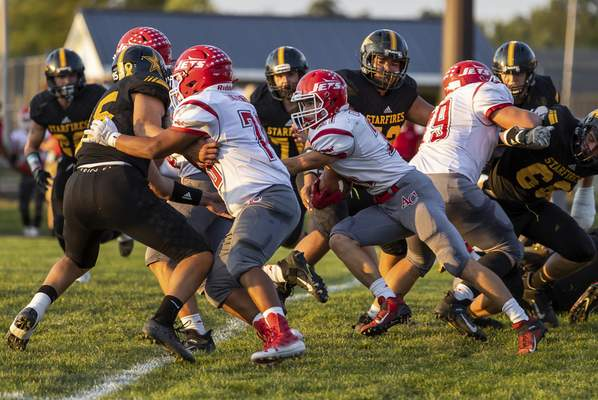 Josh Gales | Journal Gazette Adams Central junior Alex Currie carries the ball during the first quarter of the game at South Adams High School on Friday.