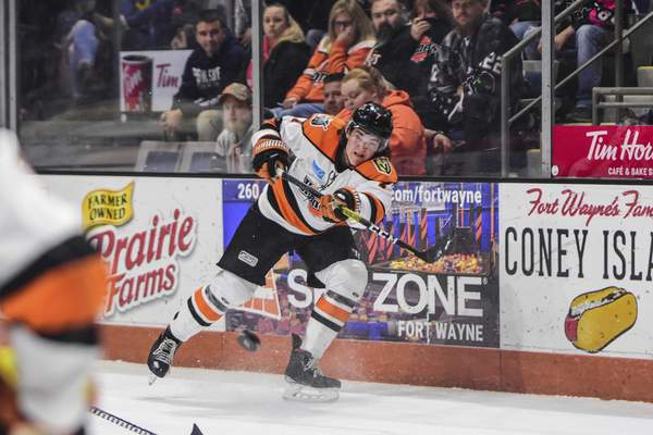 Mike Moore | The Journal Gazette  Chaz Reddekopp fires the puck last season at Memorial Coliseum, where the Komets are hoping to play again starting Jan. 15.