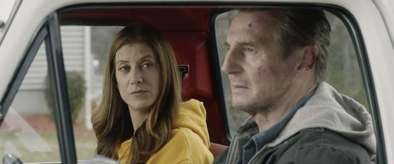 This image released by Open Road Films shows Kate Walsh, left, and Liam Neeson in a scene from Honest Thief. (Open Road Films via AP)