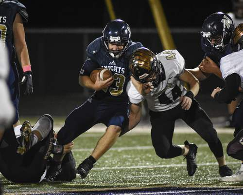 Mike Moore | The Journal Gazette  Norwell running back Max Ringger and Columbia City linebacker Ryan Elsten collide in the second quarter at Norwell High School on Friday.