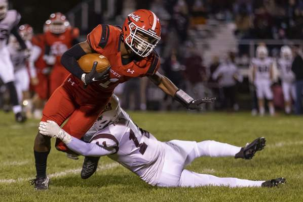 Josh Gales | Journal Gazette North Side junior Jordan Turner is tackled by Concordia's Brayden Payne during the second quarter Friday at North Side High School.