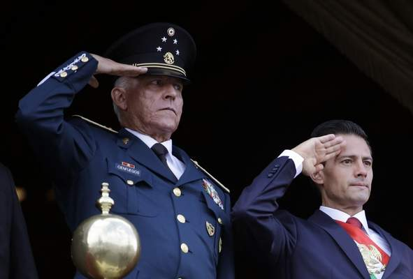 Associated Press In this Sept. 16, 2016, file photo, Defense Secretary Gen. Salvador Cienfuegos Zepeda, left, and Mexico's President Enrique Pena Nieto, salute during the annual Independence Day military parade in Mexico City's main square.