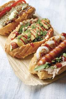 1166783618 Getty Images Create a hot dog bar for your guests to enjoy during the game. (Ihor Smishko Contributor)