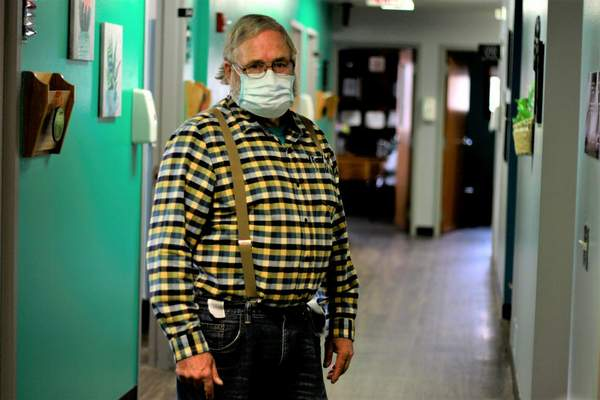 Dr. Tom Dean poses at his clinic in Wessington Springs, S.D., on Friday. Oct. 16, 2020. (AP Photo/Stephen Groves)