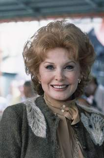 In this Sept. 28, 1981 file photo, Actress Rhonda Fleming poses for a photo in Hollywood, Calif. (AP Photo/Wally Fong)