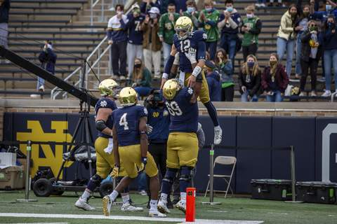 Ian Book, Aaron Banks Atlantic Coast Conference  Notre Dame quarterback Ian Book is lifted by teammates after scoring a touchdown Saturday against Louisville in South Bend. (Notre Dame Athletics)