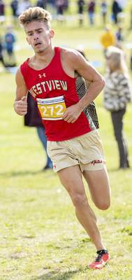 Rachel Bellwood | The Journal Gazette Westview's Remington Carpenter coming out of a corner during the Mens race at IHSAA Cross Country Regional hosted by West Noble School in Ligonier.