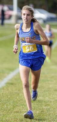 Rachel Bellwood | The Journal Gazette Homestead's Addison Knoblauch about to cross the finish line during the Womens race at IHSAA Cross Country Regional hosted by West Noble School in Ligonier.