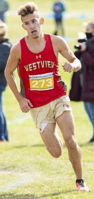 Rachel Bellwood | The Journal Gazette Westview's Spencer Carpenter coming out of a corner during the Mens race at IHSAA Cross Country Regional hosted by West Noble School in Ligonier.