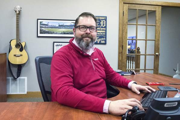 Michelle Davies | The Journal Gazette Marcus Elam will be featured in State Farm's national magazine the REFLECTOR. Elam has organized a few local businesses to provide pizza and haircuts to homeless people.