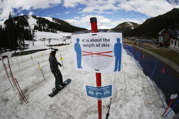 Associated Press When Arapahoe Basin Ski Resort in Keystone, Colo., reopened in May after a coronavirus lockdown, signs were posted to remindskiers and snowboarders to practice social distancing and wear a face covering in lift lines.