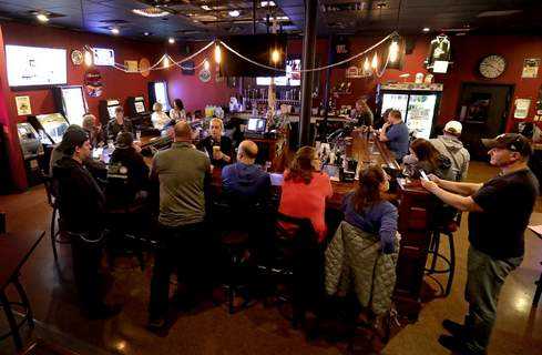 Virus Outbreak Wisconsin FILE - In this May 13, 2020 file photo, The Dairyland Brew Pub opens to patrons in Appleton, Wis. (William Glasheen/The Post-Crescent via AP File) (William Glasheen