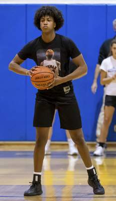 Rachel Bellwood | The Journal Gazette Homestead junior Ayanna Patterson looks to pass the ball during the first practice of the season  Monday night. Patterson is considered one of the best players in the country.