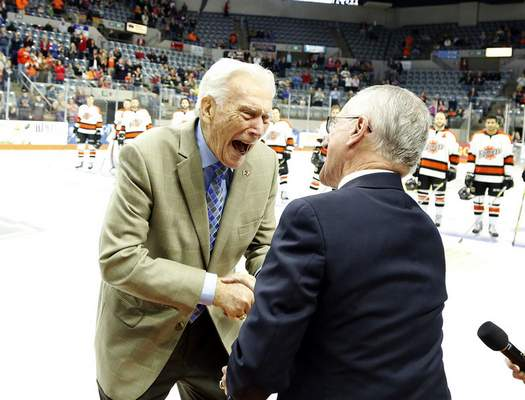 File Mike Emrick, right, surprised longtime Komets broadcaster Bob Chase, his mentor, at a 2016 game for Chase's 90th birthday.
