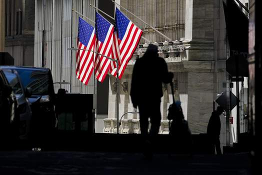 Financial Markets Wall Street FILE - In this Oct. 14, 2020 file photo, pedestrians pass the New York Stock Exchange in New York. (AP Photo/Frank Franklin II, File) (Frank Franklin II