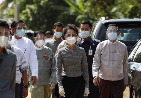 Myanmar Suu Kyi Election Myanmar leader Aung San Suu Kyi, center, wearing a protective face mask and shield walks to greet supporters as she leaves after a demonstration of the voting for the upcoming Nov. 8 general elections, Tuesday, Oct. 20, 2020, in Naypyitaw, Myanmar. (AP Photo/Aung Shine Oo) (Aung Shine Oo STF)