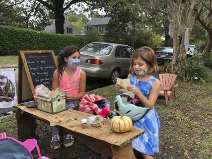 """Virus Outbreak One Good Thing Fairy Associated Press Maya Gebler and Cate Carroll read letters they've received from fairies last week at a """"fairy village"""" outside the home of a journalist and children's book author in Norfolk, Va. (Ben FinleySTF)"""
