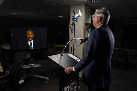 Indiana Governor Debate Associated Press Republican Gov. Eric Holcomb listens to Democrat Woody Myers on a monitor during Tuesday's Indiana gubernatorial debate, along with Libertarian Donald Rainwater,  in Indianapolis.  (Darron CummingsPOOL)